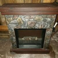 brown and black electric fireplace Akron, 44319