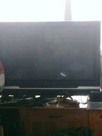 black flat screen TV with remote Toronto, M6S 3N6
