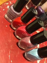 Three assorted color nail polish bottles Winnipeg, R2K 1P9