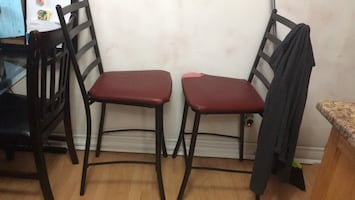 2 bar stools one needs new leather (right one)