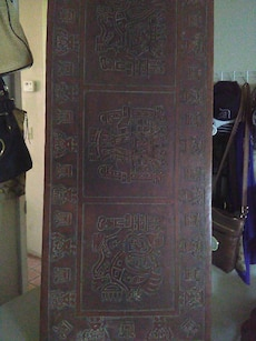 brown wooden carved panel