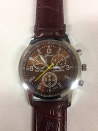 Brown leather strap silver framed round chronograph watch