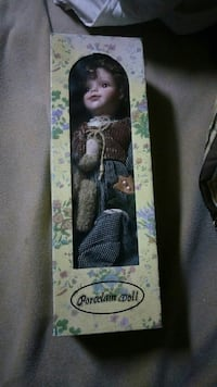 black haired porcelain girl doll with box