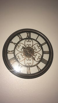 round brown and black wooden numerical wall clock Houston, 77038