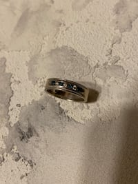 White gold ring with 4 blue diamonds and 3 diamonds