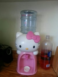 pink and white Hello Kitty water dispenser with ca