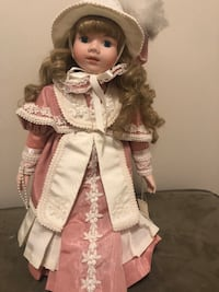 Collection of 7 Beautiful Porcelain Dolls