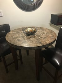 Unique Thick faux-marble table top Dark brown finish, includes (2) Dark brown upholstered chairs.  Creswell, 97426