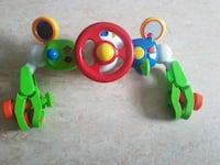 toddler's red, white and green  plastic steering wheel toy