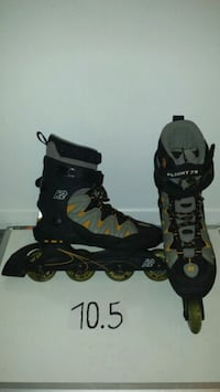 pair of black inline skates Laval, H7W 3C5