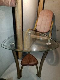 brown wooden framed glass-top table 533 km