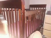 baby's brown wooden crib Clearwater, 33756
