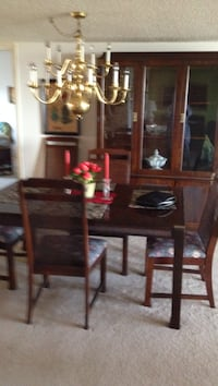 brown wooden dining table set 760 mi