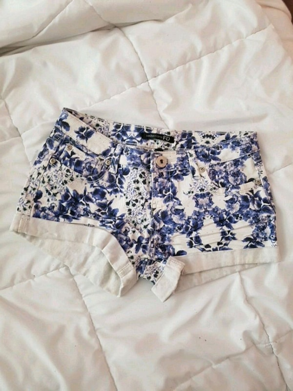 white and blue floral jean shorts