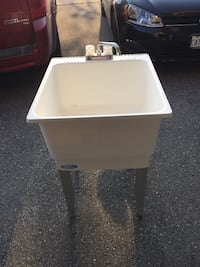 white plastic sink with faucet