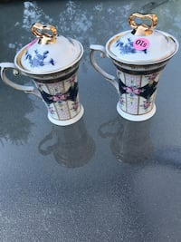 two white-and-black ceramic candle holders Montreal