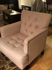 tufted white fabric sofa chair