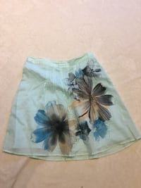 women's green, brown, and blue floral a-line skirt