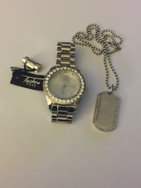 Silver watch with dog tags