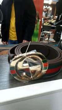 black, red, and white Gucci belt 784 km