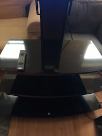 black 3-layer glass TV stand with mount