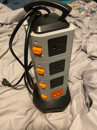 Tower surge protector with USB porta