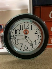 analog wall clock with black frame