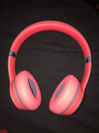 Pink and white wireless headphones
