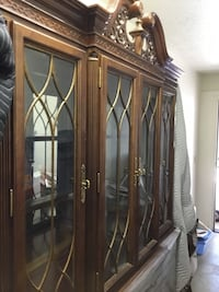 brown wooden framed glass display cabinet Albuquerque, 87111