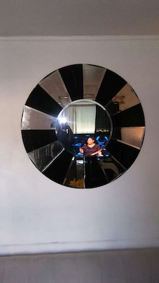 black and silver framed glass mirror