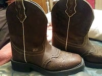 pair of brown leather cowboy boots League City, 77573