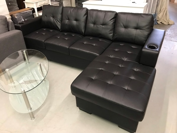 Brand new black faux leather sectional sofa with cup holder on arm rest warehouse sale