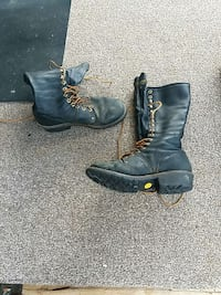 pair of black leather combat boots