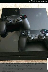 black Sony PS4 console with two controllers Edmonton, T5J
