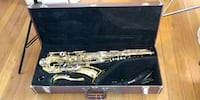 brass-colored saxophone with case Washington, 20020