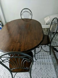 Dining Room Table - Wood/Wrought Iron and 4 matching chairs