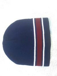 blue, white, and red striped knit cap