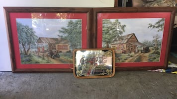 Two brown wooden framed painting of house coca col