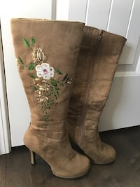 Pair of brown heeled knee-high boots