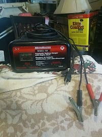 black and red MotoMaster automatic battery charger Winnipeg, R3E 0S1