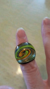 Green, gold and black glass ring Calgary, T2B 2V1
