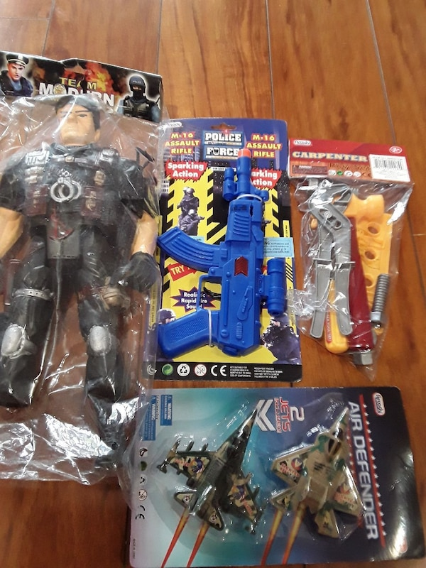 four assorted plastic toy packs