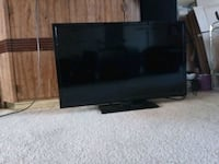black flat screen TV with remote New Carrollton, 20784