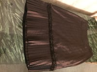Silk pleated skirt.   Brown size 4.  Local pickup only Ocean, 07712