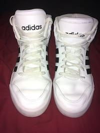 pair of white Adidas low top sneakers Russellville, 72802