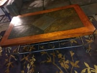 2 stone iron and wood tables