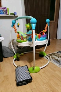baby's white and green jumperoo 3248 mi
