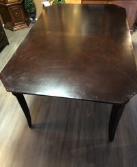 Dark cherry dining table with extension