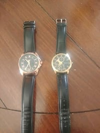 two round gold-colored analog watches with black leather straps Sainte-Marthe-sur-le-Lac, J0N