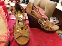pair of brown leather open toe ankle strap heels East Dublin, 31027